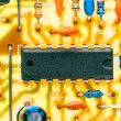 Electronic chip and other components mounted on printed circuit — 图库照片