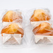 Cupcakes individually wrapped in transparent plastic — Stock Photo