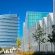 Modern office buildings glisten in the sun in a European city — Stock Photo