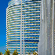Modern office buildings glisten in sun in Europecity — Stock Photo #33117125