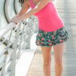 Beautiful young girl in a miniskirt skater — Stock Photo