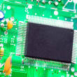 Microprocessor and other components mounted on motherboard — Stock Photo