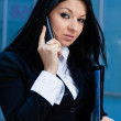 Executive woman talking on phone in an office building — Stock Photo