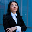 Executive woman poses in front of an office building — Stock Photo