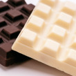 Blocks of black and white chocolate isolated on white — Stock Photo
