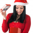 Girl with red santa claus hat — Stock Photo