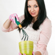 Young pretty woman prepares to gardening — Stock Photo