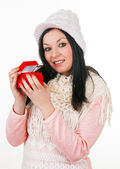 Young girl with scarf and wool hat holding a red gift box — Stock Photo