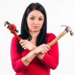 Stock Photo: Young housewife look scared some tools before beginning repair