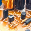 Stock Photo: Integrated circuit and other components, welded baseplate