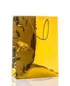 Varnished glossy gift bag of gold paper, isolated on white — Stok fotoğraf