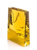 Varnished glossy gift bag of gold paper, isolated on white — Стоковое фото