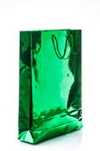 Gift bag varnished bright green paper, isolated on white — Stok fotoğraf
