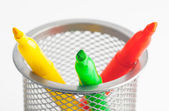 Green fluorescent yellow and orange markers within bucket — Stock Photo