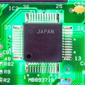 Mounted microprocessor motherboard lit below — Stock Photo