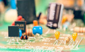 Transistor surrounded by other components mounted on motherboard — Stock Photo