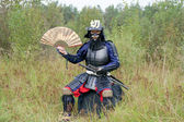Samurai with Japanesse fan — Stock Photo