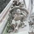 Stock Photo: Allegory of hearing on main portal of Protestant Church