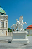 Sculpture of a man with horse near Upper Belvedere, Vienna, Aust — Stock Photo