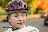 Young girl in fall wearing bicycle helmet — Stock Photo