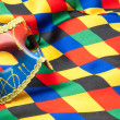 Mask and cloth of harlequin — Stock Photo