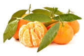 Tangerine with leaves on a white background — Stock Photo