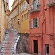 Street in Menton, narrow houses - Stock Photo