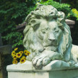 Sleeping lion sculpture - Stock Photo