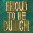 Earthy background image and design element depicting the words Proud to be Dutch — Stock Photo