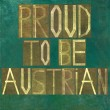 "Earthy background image and design element depicting the words ""Proud to be Austrian"" - Stock Photo"