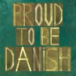 "Earthy background image and design element depicting the words ""Proud to be Danish"" - Stock Photo"