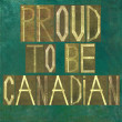 "Stock Photo: Earthy background image and design element depicting words ""Proud to be Canadian"""