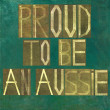 "Earthy background image and design element depicting words ""Proud to be Aussie"" — Stock Photo #25338555"