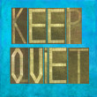 Earthy background image and design element depicting the words Keep quiet — Stock Photo