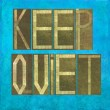"Earthy background image and design element depicting the words ""Keep quiet"" - Stock Photo"