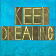 "Earthy background image and design element depicting the words ""Keep dreaming"" — Stock Photo"