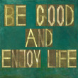 "Earthy background image and design element depicting the words ""Be good and enjoy life"" - Stock Photo"