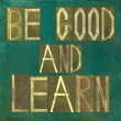 "Earthy background image and design element depicting the words ""Be good and learn"" - Stock Photo"