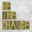 """Earthy background image and design element depicting the words """"Be the change"""" — Stock Photo #25564333"""