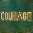 "Earthy background image and design element depicting the word ""courage"" — Stock Photo"
