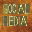 Earthy background image and design element depicting the word Social media - Stok fotoğraf