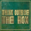 "Earthy background and design element depicting the words ""think outside the box"" - Stock Photo"