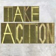 "Stock Photo: Earthy background image and design element depicting words ""Take action"""