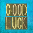 "Stock Photo: Earthy background and design element depicting the words ""Good luck"""