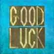 "Earthy background and design element depicting the words ""Good luck"" — Stock Photo"