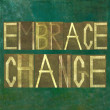 "Earthy background image and design element depicting the words ""embrace change"" - Stock Photo"