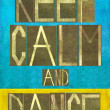 "Earthy background image and design element depicting the words ""Keep calm and dance"" - Stock Photo"