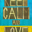 "Earthy background image and design element depicting the words ""Keep calm and love"" — Stockfoto"