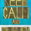 "Earthy background image and design element depicting the words ""Keep calm and simplify"" — Stock Photo"