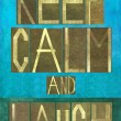 "Earthy background image and design element depicting the words ""Keep calm and laugh"" — Stock Photo"